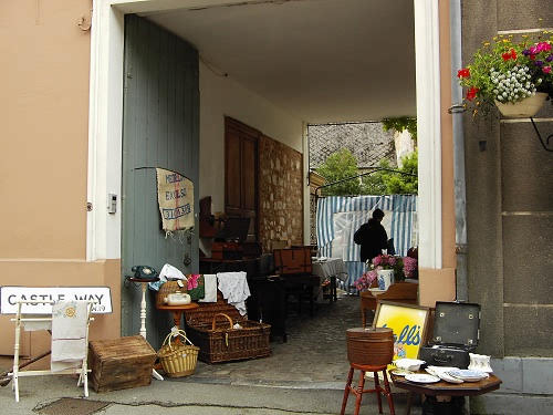 Setting up in the garage, Montreuil-sur-Mer Antiques Fair