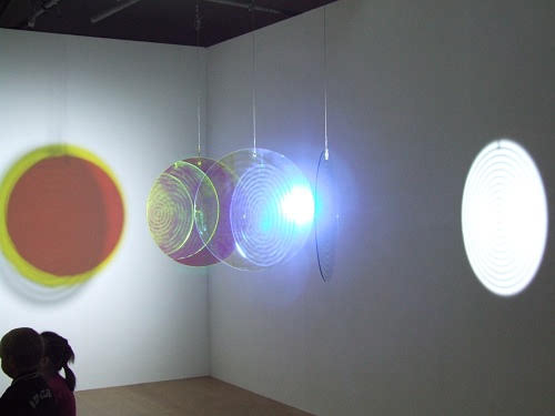 Optical glass and mirror disc and lamp sculpture by Olafur Eliasson