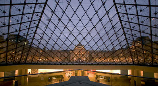 View of the Paris Louvre from the top of the glass pyramid in the courtyard