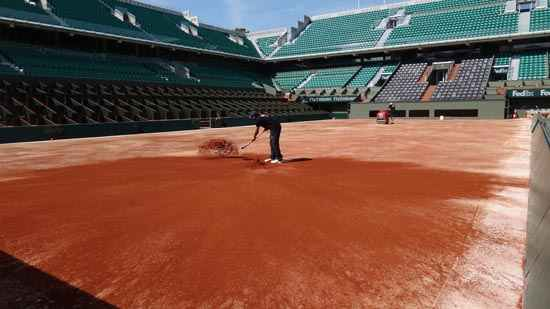 preparing the red clay courts Roland Garros