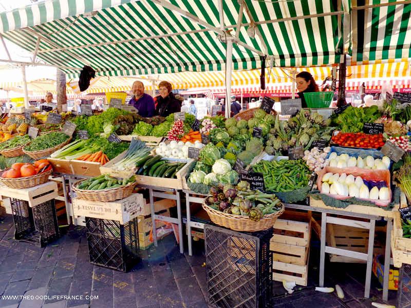 course saleya Nice market stall selling vegetables