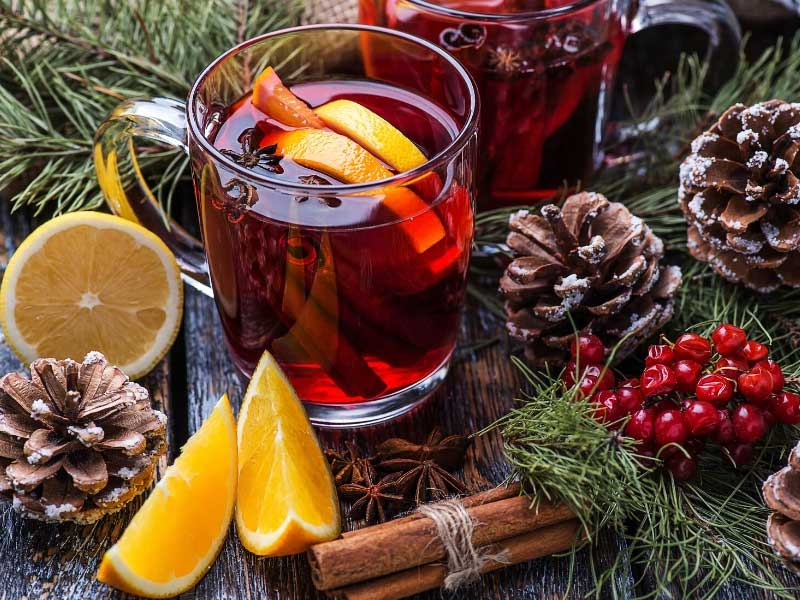 Glass of vin chaud, spicy warm wine, with slices of lemon