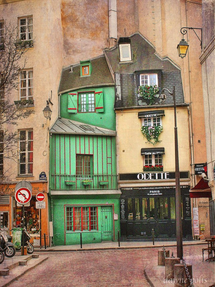 Two narrow houses, one a cafe called Odette, built into a cliff like wall in the Sorbonne area of Paris