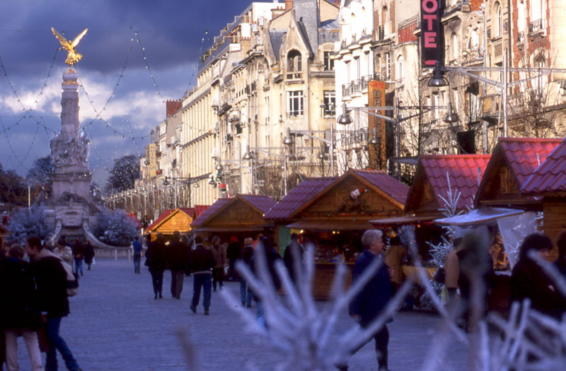 Christmas chalets along a street lined with Parisian style buildings in Reims, Champagne