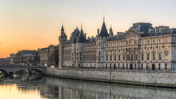 Conciergerie building Paris at dusk