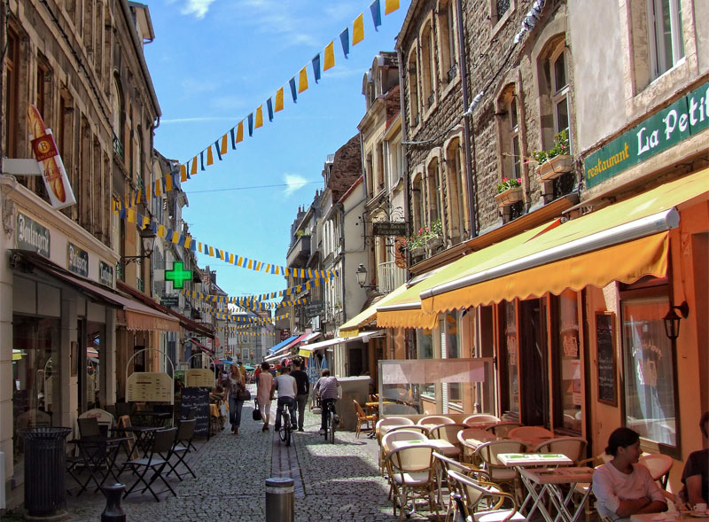 Cobbled street, hung with colourful bunting and lined with quirky shops and bars in Boulogne-sur-Mer