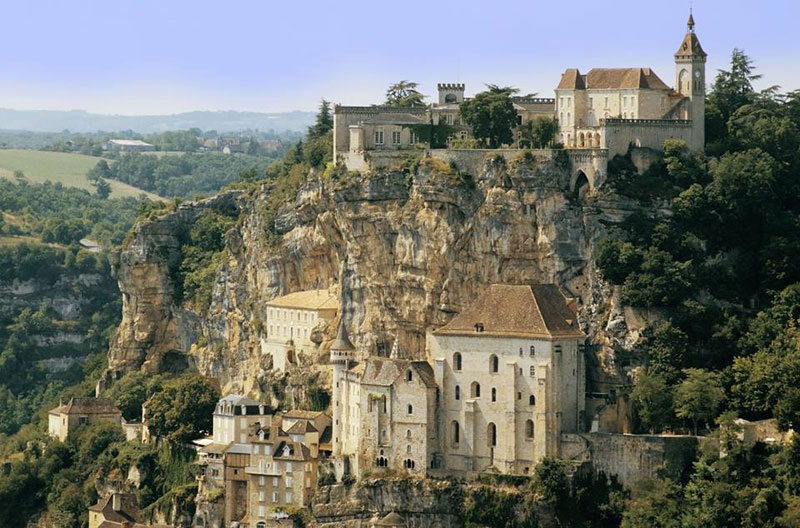 Buildings on top of a steep cliff and built into its sides at Rocamadour, Dordogne Valley