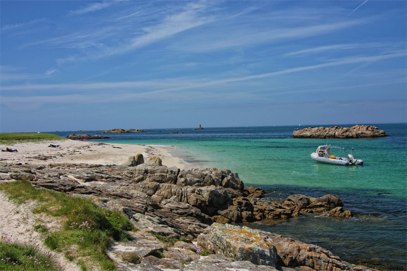 Turquoise clear water around the rocky Glennan Islands, Brittany