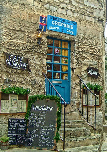 steps to a cafe set in a stone wall at les Baux de Provence