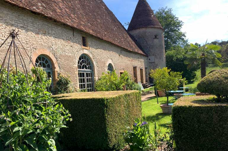 Beautiful castle with a tower and floral gardens in Burgundy