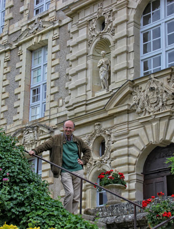 Marquis de Brissac standing on the stairs that lead to the Chateau where he lives,