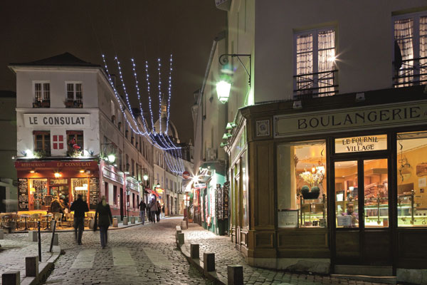 The cobbled streets of Montmartre lit up at Christmas