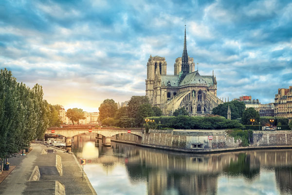 Notre Dame Paris lit up by a rain of sunlight