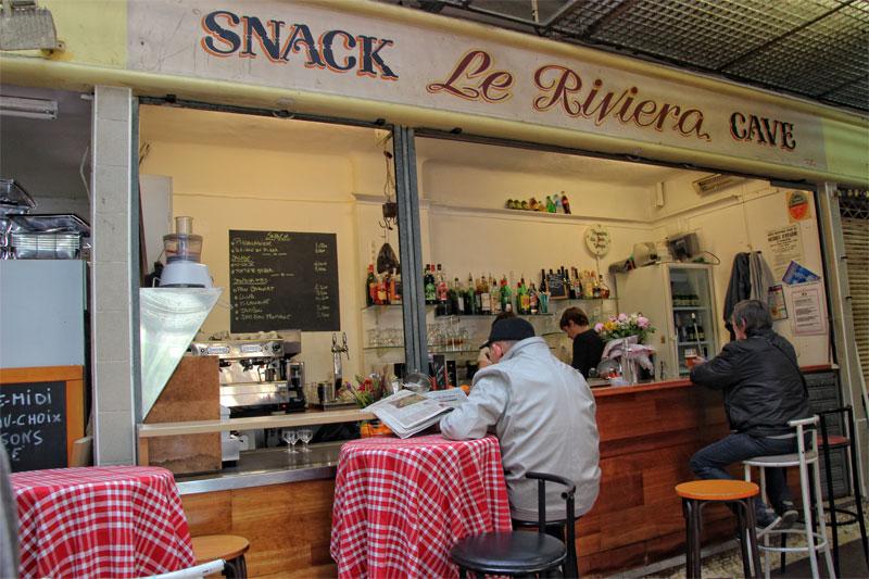 men sitting on bar stalls enjoying a break at a cafe