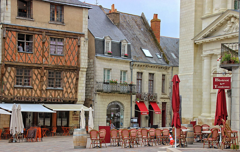 Half timbered houses and ancient buildings line a square in Saumur, Loire, France
