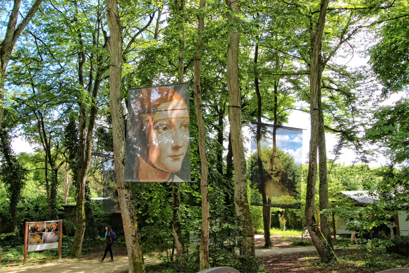 gardens of the chateau du clos luce with large images of Leonardo da Vinci's famous works hanging from trees