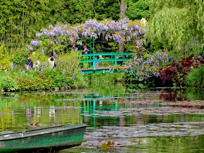 The lily pond at Monet's garden in Giverny, a wooden bridge over which flowers grow