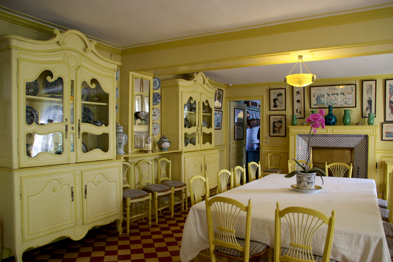 Dining room of Claude Monet's Normandy house, predominantly painted yellow