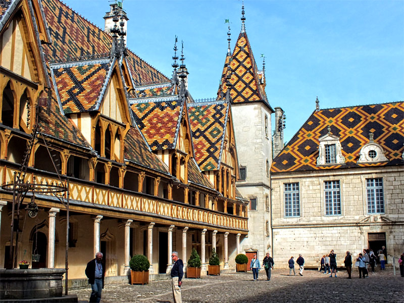 Centuries old hospital with colourful glazed tile roof in Beaune, Burgundy