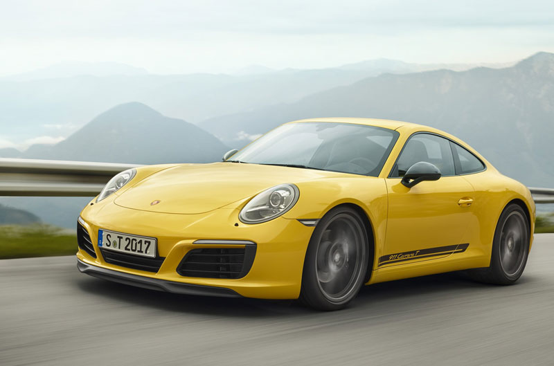Yellow Porsche on an empty road