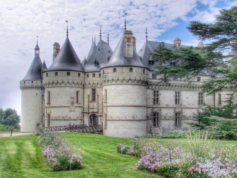 Fairy tale like castle of Chaumont with pointy towers and a wooden draw bridge
