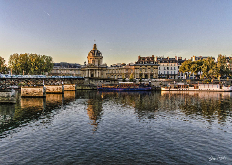 The Ricer Seine flows past the domed building of the Academie Francaise