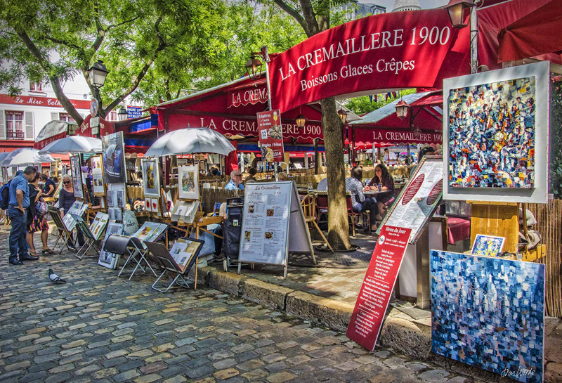Artists with easels on the cobbled streets of Montmartre, Paris