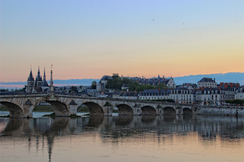 View of the city of Blois, Loire Valley, pointed towers of the castle, arched stone bridge, old houses