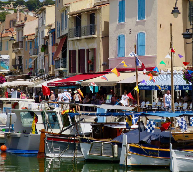 Colourful boats and bunting along the edge of the harbour of Cassiss in Provence