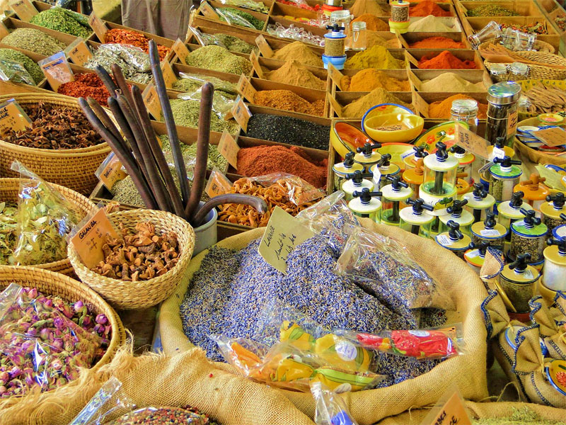 Colourful market stall in Provence brimming with spices and herbs