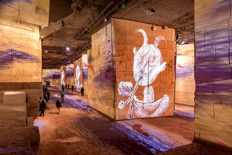 Inside a huge stone quarry in Provence now a huge digital art centre, art projected on walls