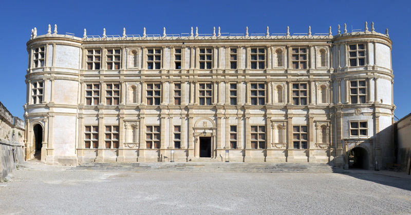 Renaissance style castle of pale stone with many windows in Drome, France