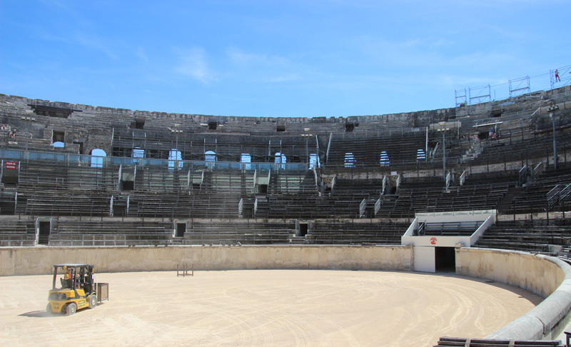 Roman arena of Nimes, oval shaped and surrounded by stone benches