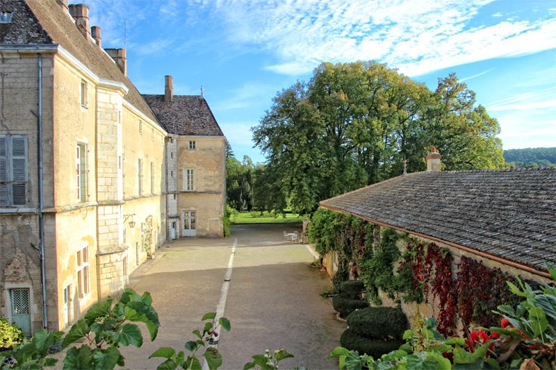 Ancient mellow stone walls of Chateau de Germolles Burgundy