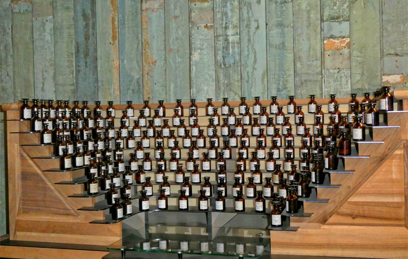 Perfume bottles arranged in an organ like fashion