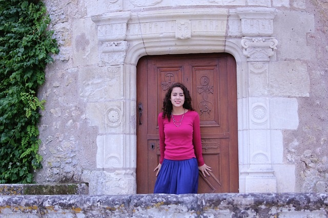 Solo house sitter in France at the front door of property she is caring for