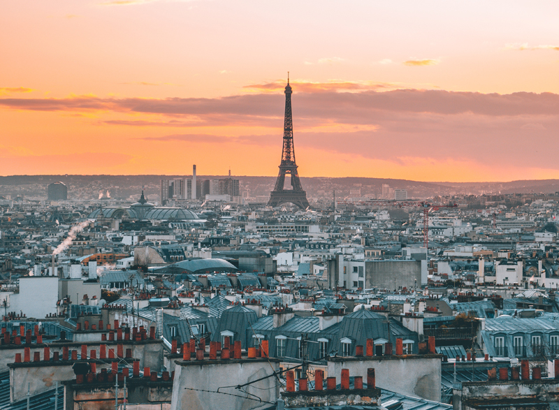 Sunset over the rooftops of Paris, the Eiffel Tower in the background