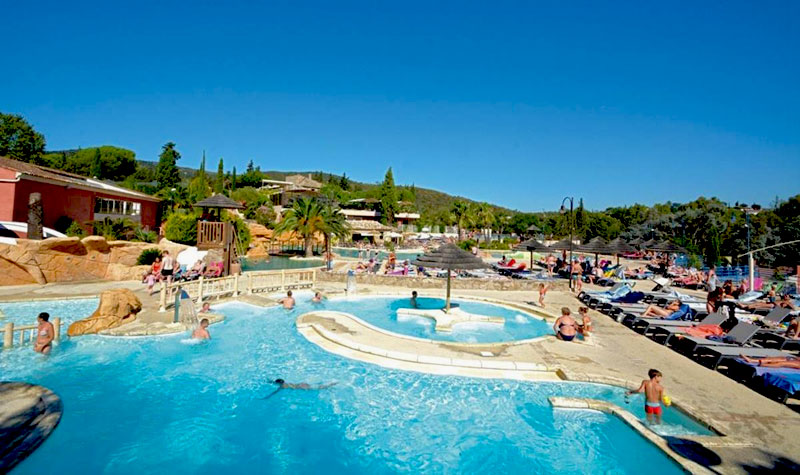 Swimming pool under a blue sky at the camping site Castel Domaine de la Bergerie in Provence