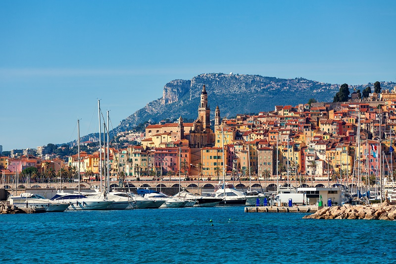 The colourful town of Menton, southern France clings to a hill and leads right down to the edge of the Med