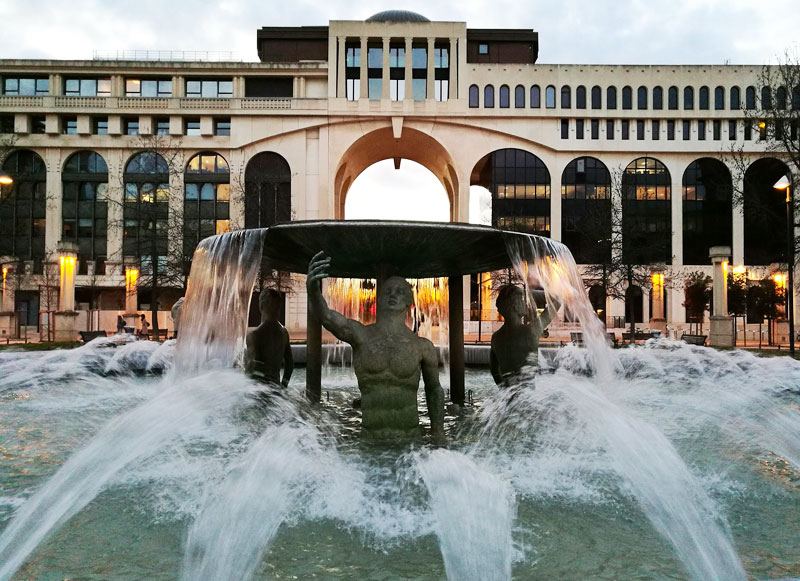 Statue and fountains before one of the modern buildings in the new part of Montpellier, France