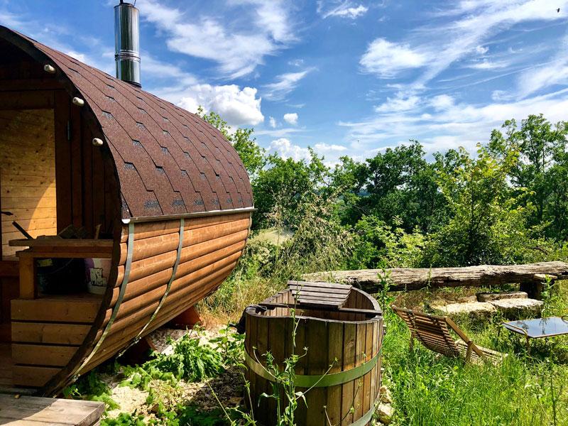 Barrel shaped sauna at The Happy Hamlet retreat in France