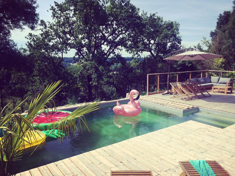 pink flamingo float in pool at Happy Hamlet