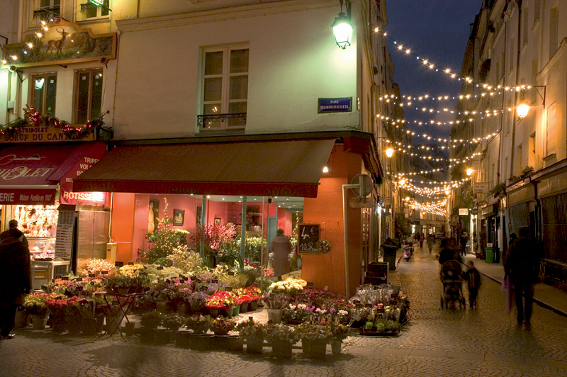 Rue Montorgueil in Paris with Christmas lights looking festive