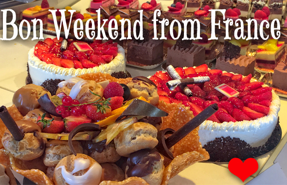 Cream cakes with chocolate and fruit decorations with Bon Weekend from France across the top