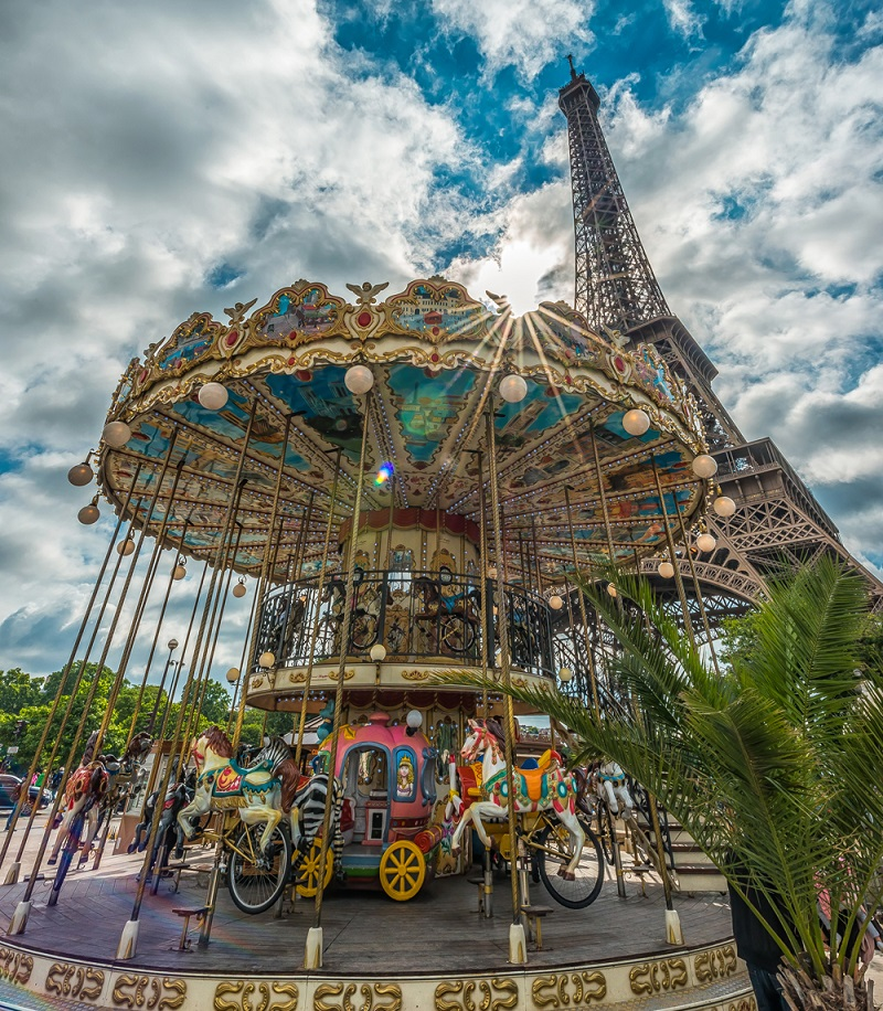 Childrens carousel at the Eiffel Tower, authentic and colourful