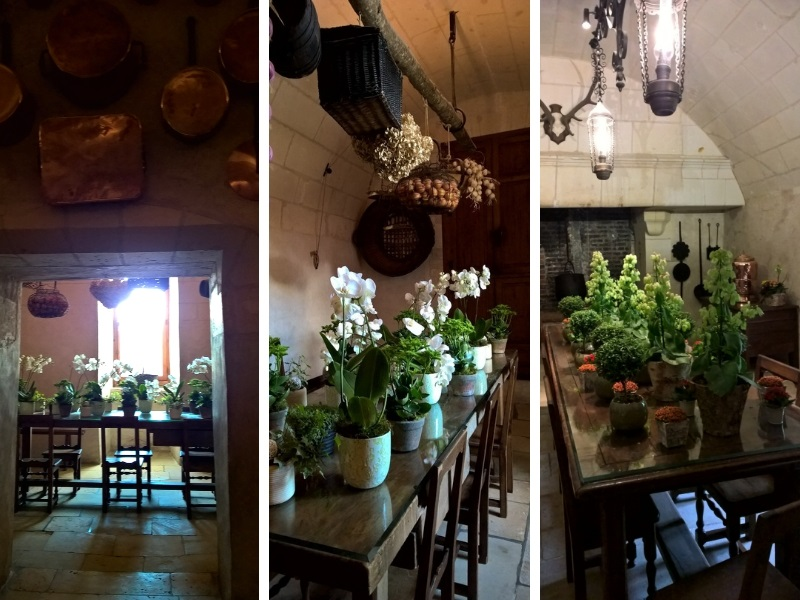 Antique furniture and copper pans, tables covered with floral bouquets