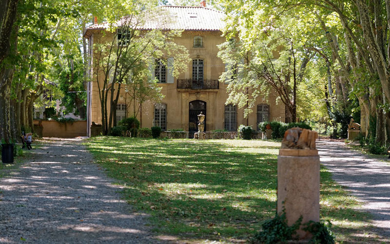 Beautiful Provencal style house where artist Paul Cezanne once lived in Aix-en-Provence, trees shade the garden