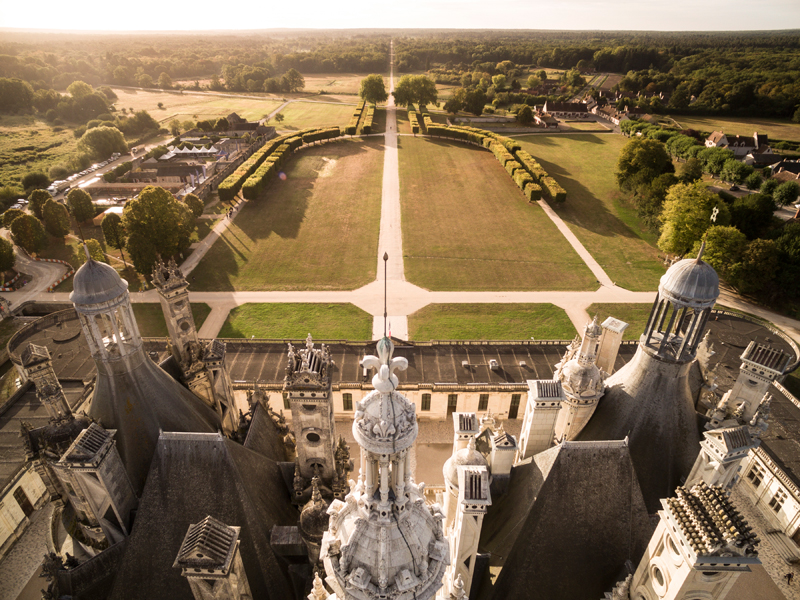 Aerial view of the Chateau de Chambord up close to its towers sticking up like peaks on a pie