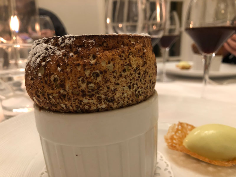 chocolate souffle that's risen high out of the dish