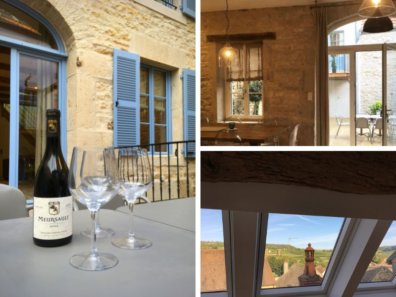 A holiday cottage in Burgundy, wine and glasses on the table and views over the countryside